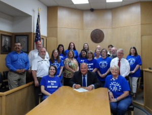 Fannin County Judge signs a proclamation declaring April to be Child Abuse Awareness Month in Fannin County.