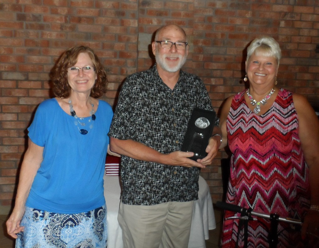 Alan Schmidt was named the CASA Advocate of the Year.  From left, Jana Wood, Schmidt, and Sandy Hood at the volunteer banquet for the Fannin County Children's Center.