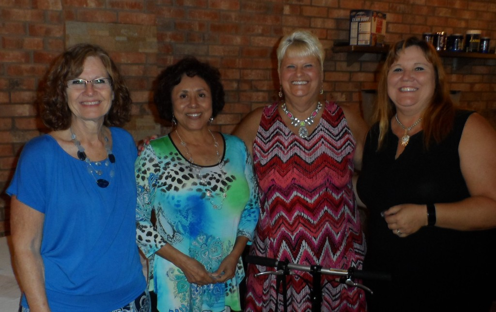 Jo Dophied earned her 5 year service pin and Ranea Lynch earned her 3 year service pin for being CASA volunteer advocates. (From left) Jana Wood, Jo Dophied, Ranea Lynch and Sandy Hood.