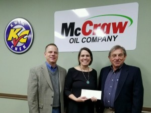 Kwik Chek/McCraw Oil owner Doyce Taylor (right) and McCraw Oil President Bill Wilson (left) present a donation of $13,100 to the Children's Center's Executive Director Sandy Barber.