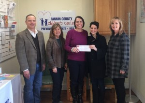 The Texoma Health Foundation recently presented a grant for $50,000 to the Fannin County Children's Center. Pictured here is Bill Wilson, President of McCraw Oil and Texoma Health Foundation board member, Kyra Barsi, Board President of the Children's Center, Sandy Barber, Executive Director of the Children's Center, Nicole Thornhill, Manager of Development for Texoma Health Foundation and Kitty Richardson, Chief Operating Officer of Texoma Health Foundation.
