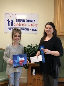 Grace Farrell won first place in the Open Your Heart art contest. She is pictured with CAC therapist Michelle Griffith.