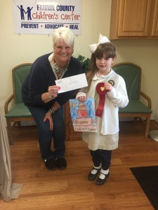 Rowan Davis won second place in the Open Your Heart art contest. She is pictured with CASA Program Director Sandy Hood.