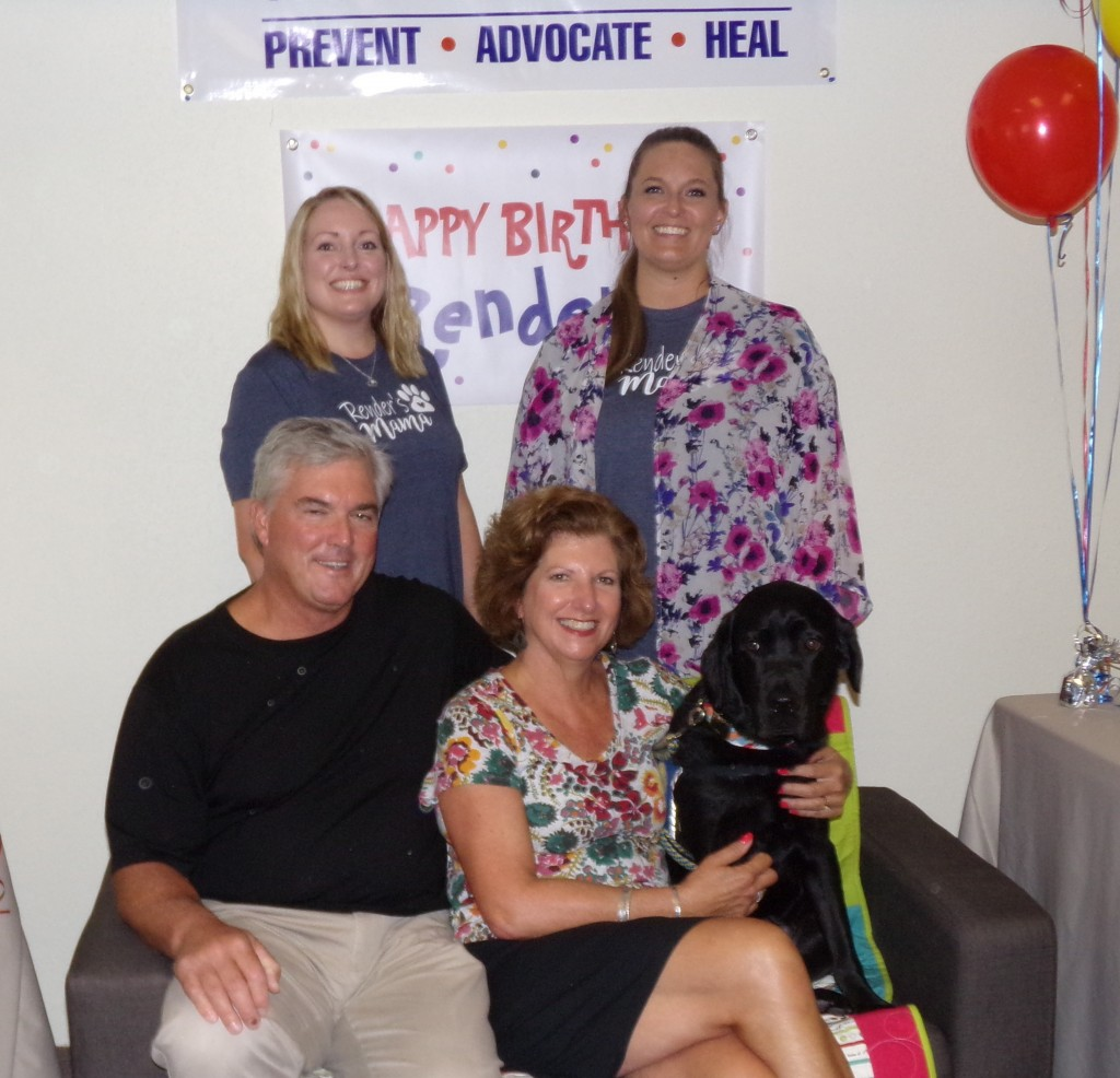 Render's puppy raisers and current handlers posed for a photo together at Render's birthday party.  Back row, from left, Mandi Bruso and Kassi Lighfoot. Seated, from left, Kresten and Kimberly Cook and Render.