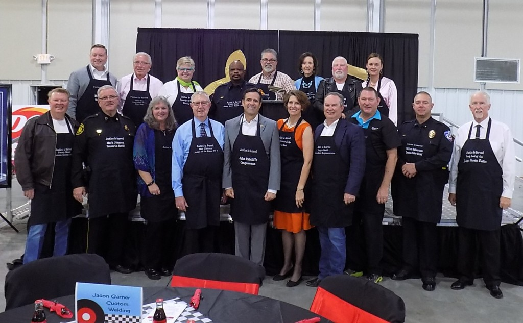 Honorable servers who served up dinner for guests at the Justice Is Served fundraiser for the Fannin County Children's Center included (front row, from left)  Fannin County Judge Randy Moore, Fannin County Sheriff Mark Johnson, Fannin County Clerk Tammy Biggars, Justice of the Peace, Pct 2 Bob Clemons, US Representative John Ratcliffe, 336th District Judge Lauri Blake, State Representative Reggie Smith, Justice of the Peace, Pct 3 Kenneth Karl, Trenton Police Chief William Robertson, County Court at Law Judge Charles Butler (back row, from left) John Vick for State Senator Bob Hall, Fannin County Criminal District Attorney Richard Glaser, Fannin County District Clerk Nancy Young, Honey Grove Police Chief Leigh Dixon, Juvenile Probation Chief Brandon Caffee, Adult Probation Chief Debra Roberts, Savoy Police Chief Carl Harrell and Whitewright ISD Police Chief Judy Sims.