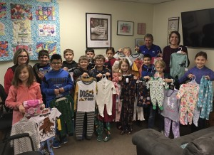 Third graders from Ector Elementary school collected 72 pairs of pajamas and several books for the Fannin County Children's Center for Christmas.